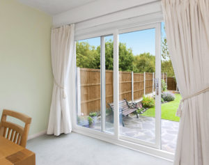 Patio doors with white curtains