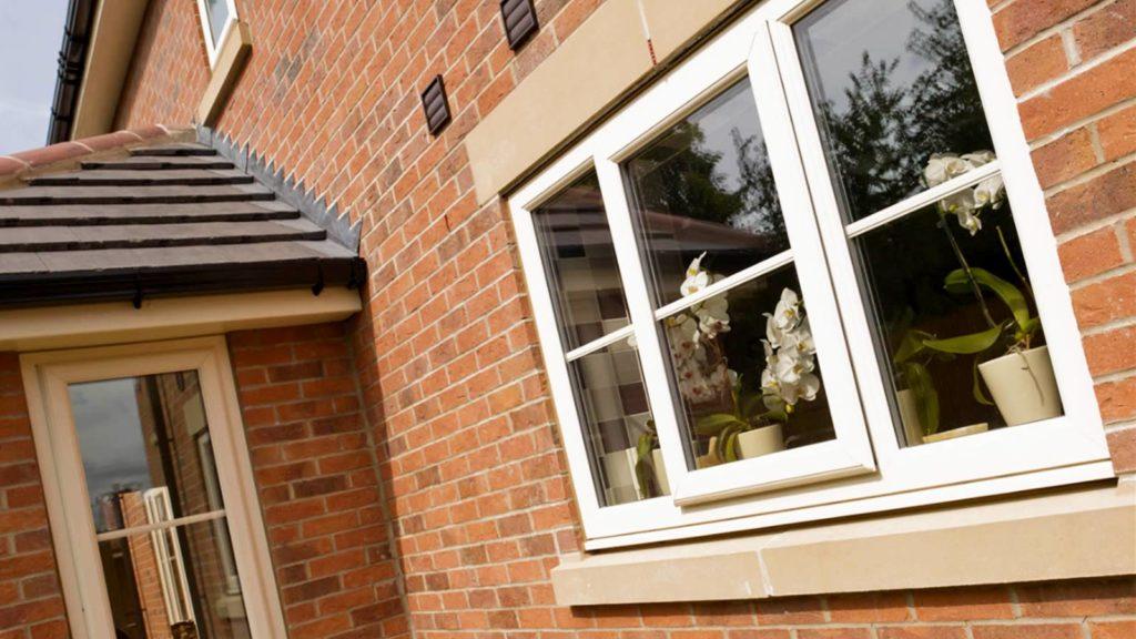 triple glazed windows on the side of a house