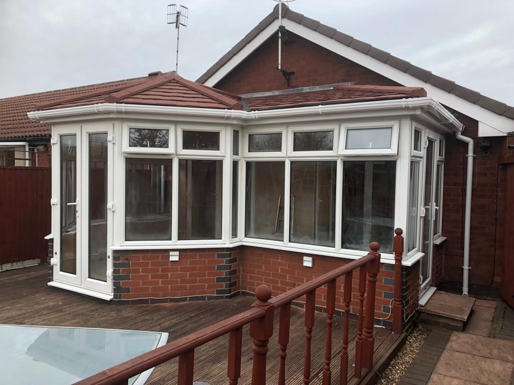 Conservatory with a newly completed tiled roof