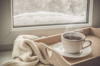 Tea on tray in front of a window