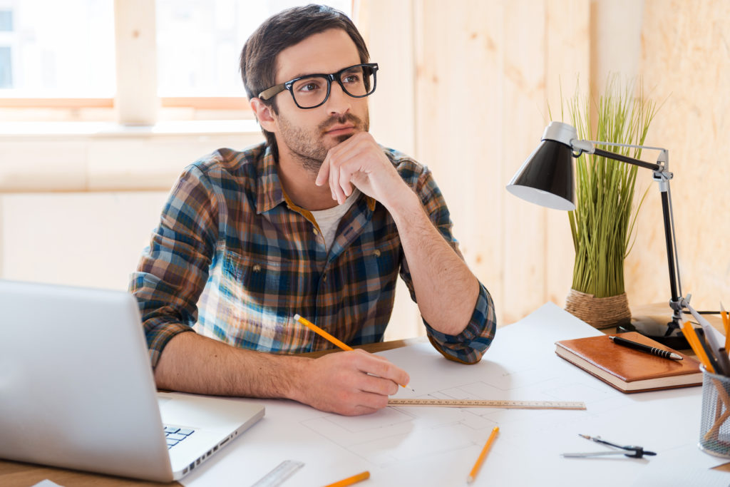man planning with windows in the background