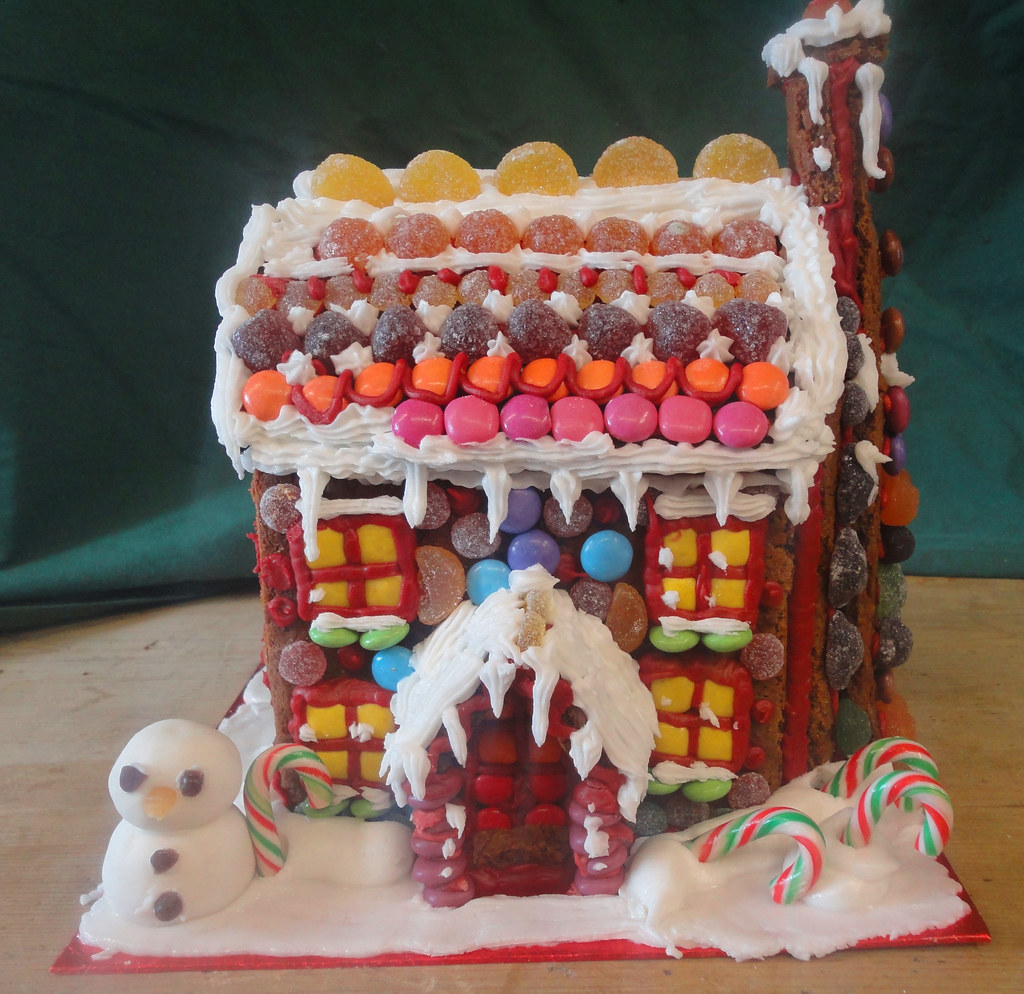 Gingerbread house covered in sweers, with excellent Smartie windows.