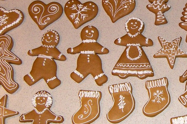Family of gingerbread people wearing different clothes, alongside other shapes.